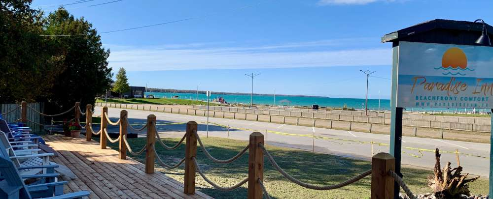 Large front deck for relaxing with spectacular beach & sunset viewing